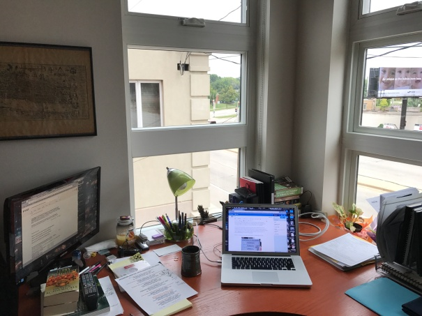 Corner Window Workspace with Computer and Papers