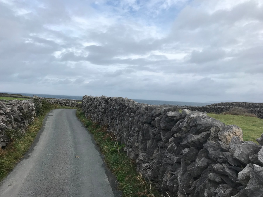 Stone walls, concrete road, Atlantic Ocean